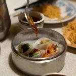 Chili oil on shrimp and snow pea leaf dumplings